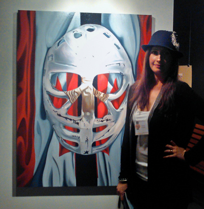 realistic painting of goalie mask on Canadian flag with the artist Brandy Saturley