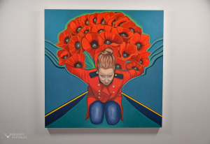 painting of woman with red poppies on a wall