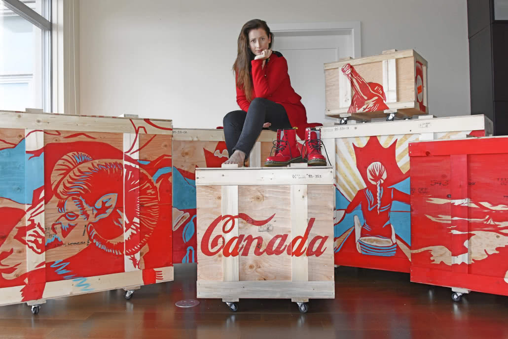 photograph of Canadian artist Brandy Saturley sitting on her art canada painting collection