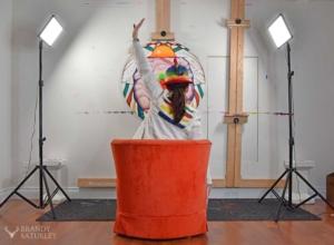 Brandy Saturley with her art in her studio