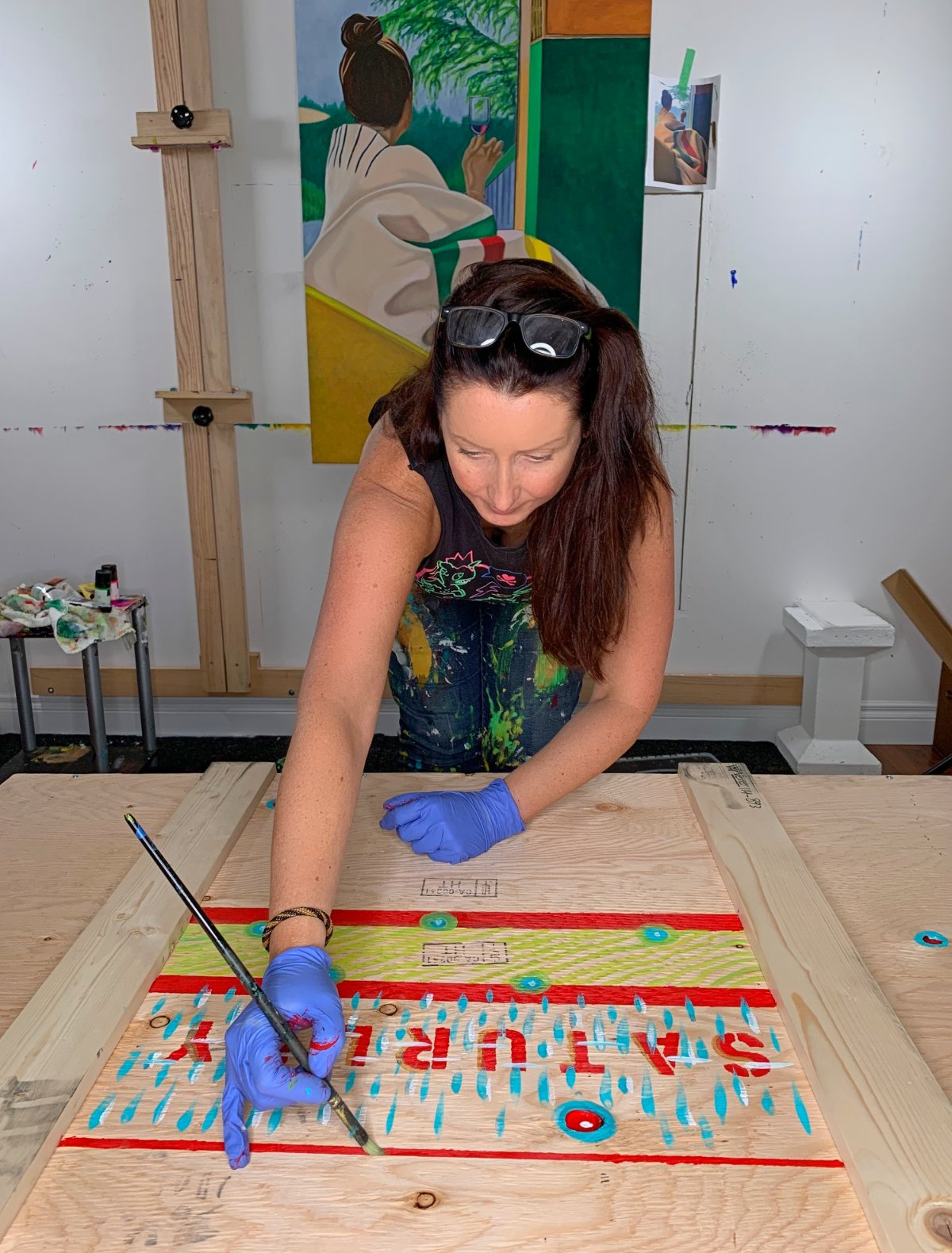 Canadian painter Brandy Saturley preparing her art shipping crates