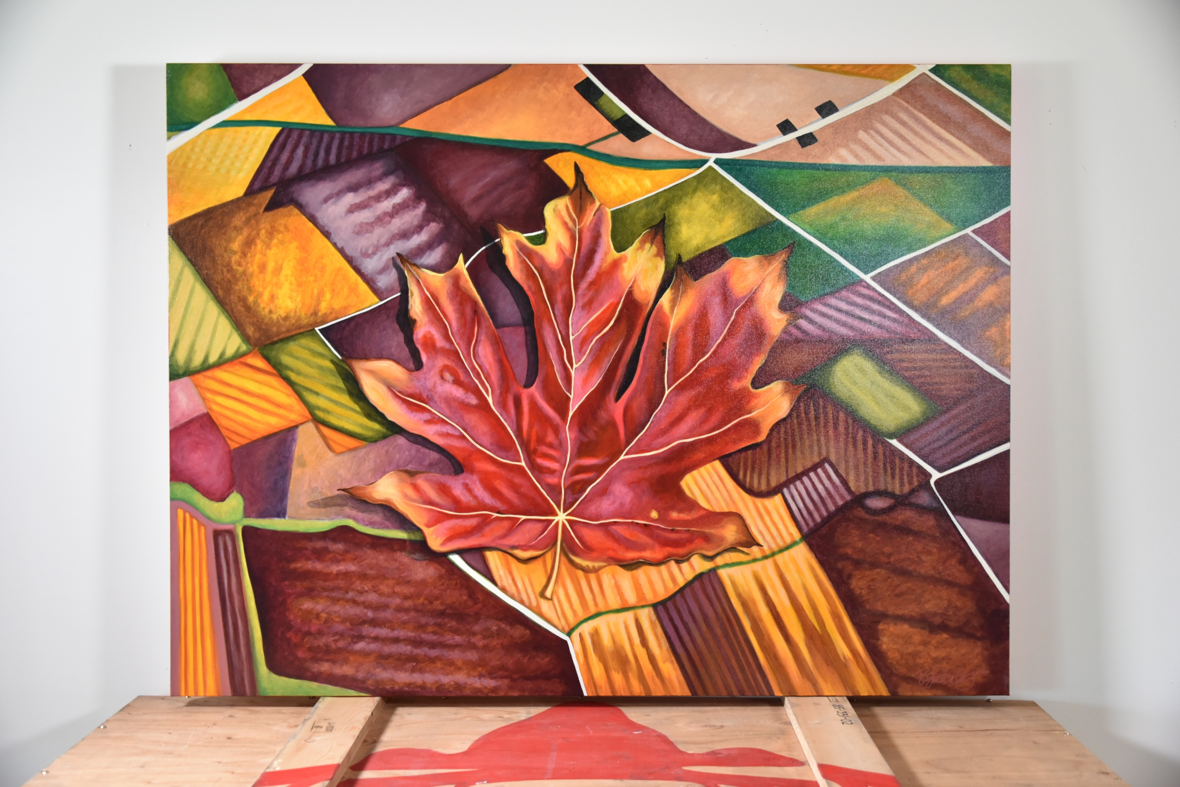 painting of maple leaf on prairies
