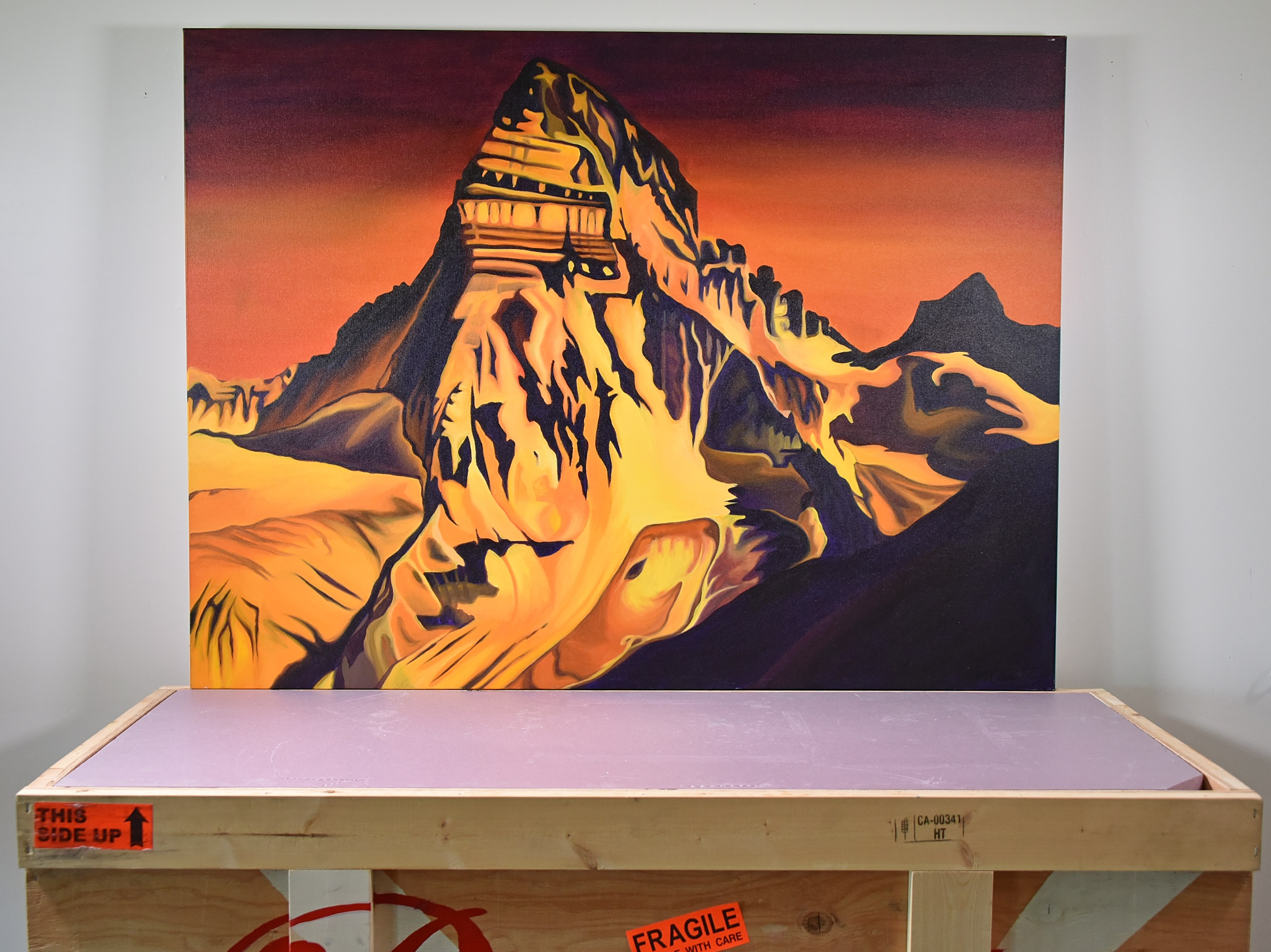 a painting of mount assiniboine
