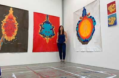 Brandy Saturley with her paintings at RCA Sackler Studios