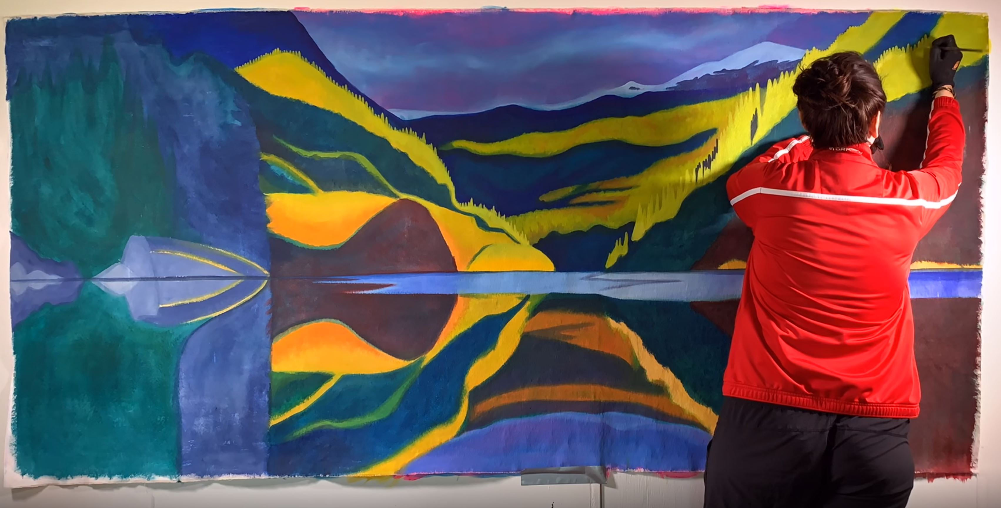 canadian artist brandy saturley painting in her studio