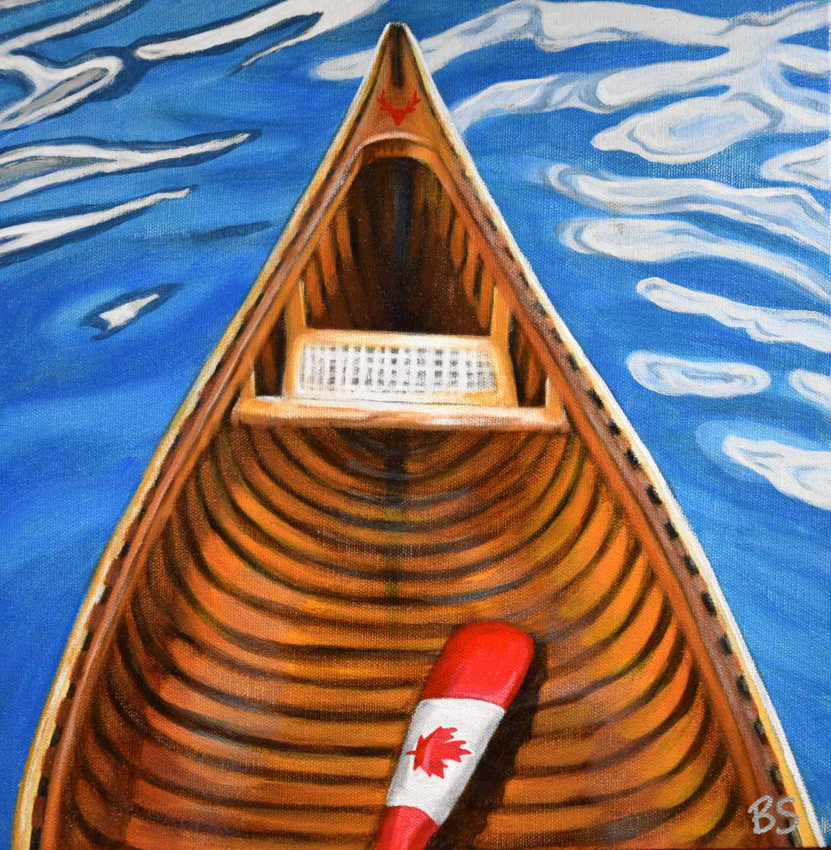 a canoe and a canada flag paddle