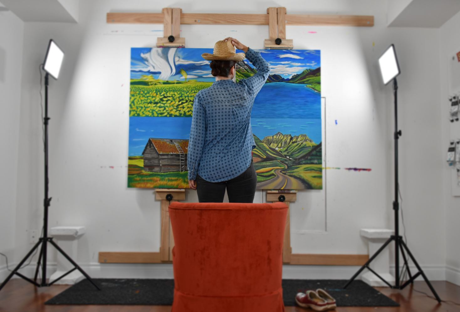 Canadian Artist Brandy Saturley in her studio with landscape paintings